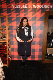 Mindy Kaling layered a sleeveless navy coat over a print dress for the Vulture Spot during Sundance Film Festival.