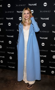 Elle Fanning brought a cool pop of color to the Sundance screening of 'The Alienist' with this sky-blue coat by The Row.