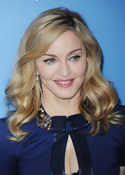 Madonna attended a photocall for 'W.E.' wearing her blond tresses in loosely tousled waves.