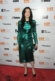 Andrea Riseborough shined on the red carpet in an emerald green sequined frock. She finished off the look with black pumps.