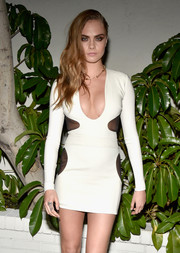 Cara Delevingne brought the sexy to W Magazine's Golden Globes bash in this figure-hugging number by Tom Ford.