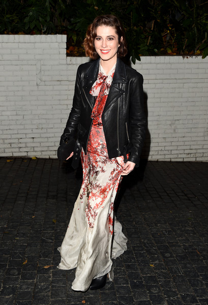 Mary Elizabeth Winstead paired edgy with elegant in a black moto jacket and red and white printed gown.