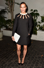 Paula Patton arrived at W Magazine's Golden Globe party wearing a beautiful black shift dress with an interesting cutout neckline and floral collar by Valentino.