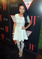 Jeannie Mai added major glitter to her all-white outfit with a pair of gold ankle boots.