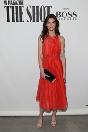 Hilary Rhoda's nude broad-strap mules and red frock (both by Boss) were a super-stylish pairing!