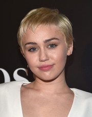 Miley Cyrus wore her pixie slightly tousled at the W Magazine Shooting Stars exhibit opening.
