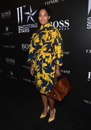 Tracee Ellis Ross donned a kimono-inspired dress in a striking yellow and dark teal floral print for the W Magazine Shooting Stars exhibit opening.
