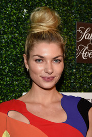 Jessica Hart rocked a sky-high top knot while attending WCRF's 'An Unforgettable Evening' event.