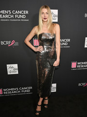 Jessica Hart went for simple styling with a black box clutch.
