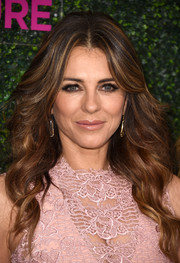 Elizabeth Hurley was glamorously coiffed with this long wavy 'do while attending WCRF's 'An Unforgettable Evening' event.