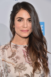 Nikki Reed attended WE Day California wearing her hair in a glamorous side sweep.