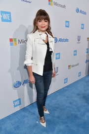 Paula Abdul wore a white motorcycle jacket with her jeans for a chicer finish.