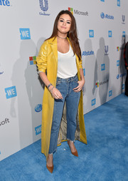 Underneath her coat, Selena Gomez was casual in Vetements high-waisted jeans and a white shirt.