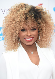 Fleur East attended the WE Day celebration wearing her hair in a mop of tight curls.