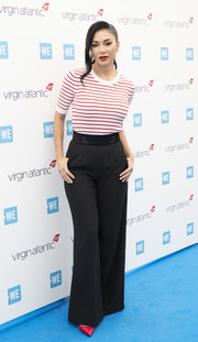 Nicole Scherzinger was casual yet stylish in a red and white striped knit top at WE Day UK 2019.