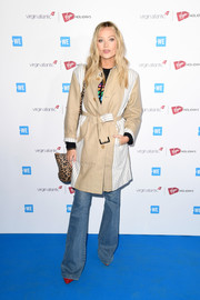 Laura Whitmore sported a khaki trenchcoat with striped panels during WE Day UK 2020.