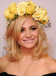 Pixie finished off her flower child vibe with her bright pink lips.