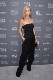 Carolyn Murphy went for easy elegance in a strapless black jumpsuit at the WSJ. Magazine 2017 Innovator Awards.