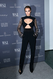 Cara Delevingne looked foxy in a black cutout jumpsuit by David Koma at the 2018 Innovator Awards.