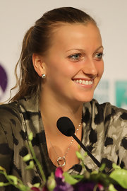 Petra accessorized with dainty silver hoops and a matching necklace.
