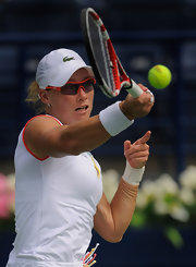 Samantha Stosur wore matching red-framed sunglasses while playing in the Dubai Championships.