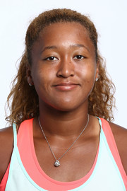 Naomi Osaka wore her hair in a half-up style for her WTA portrait.