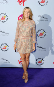 Maria Sharapova looked whimsically chic at the WTA pre-Wimbledon party in a nude Valentino mini dress with pastel beading.