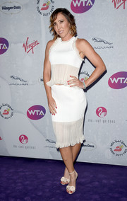 Jelena Jankovic went ultra girly in a sleeveless white ruffle blouse for the WTA pre-Wimbledon party.