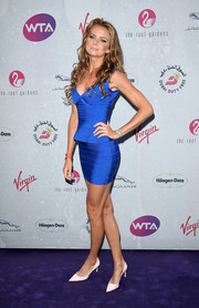 Daniela Hantuchova sizzled in a blue peplum bandage dress by Herve Leger at the WTA pre-Wimbledon party.