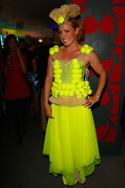 Bethanie Mattek-Sands showed a zany fashion sense (and her deep love for the sport) with this tennis ball-embellished neon-yellow corset dress.