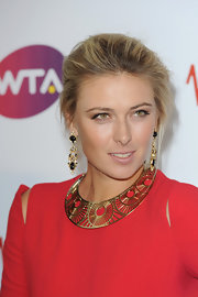 Maria Sharapova accented her Alexander McQueen dress with a gold Tatijana choker. The necklace has a ribbon fastening at the back and sits snug around the neck. An amazing statement necklace for her ensemble.