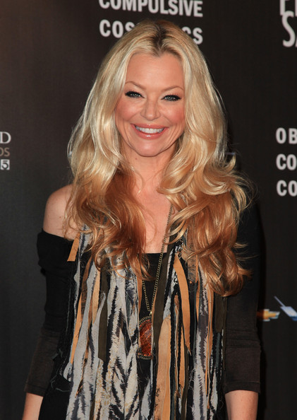 Charlotte Ross showed off her radiant center part curls while hitting the WTB Fashion Show.
