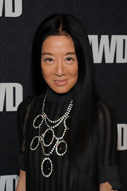 Vera Wang spiced up her turtleneck with a large statement necklace. A solid ensemble such as this is a great way to showcase statement jewelry.