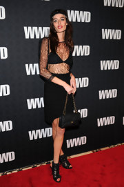 Nicole Trunfio rocked a pair of peep toe lace-up boots. She paired the shoes with a racy sheer lace dress.