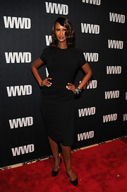 Iman donned a LBD at the 'WWD' soiree in NYC. She paired the look with layered bracelets and classic patent leather pumps.