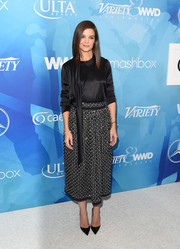 Katie Holmes kept it simple up top in a long-sleeve black silk blouse when she attended the Stylemakers event.