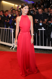 Alessandra Mastronardi kept it simple yet chic in a sleeveless red gown at the Venice Film Festival screening of 'Waiting for the Barbarians.'