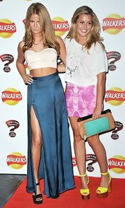 Caggie Dunlop posed with a co-star wearing a tie-dye bandage skirt at an event hosted by Walkers.