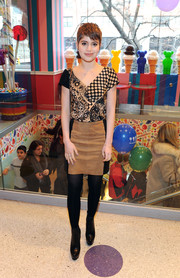 Sami Gayle chose a tan and black suede mini skirt to pair with her print blouse.