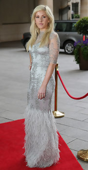 Ellie Goulding stunned in a silver gown that featured beaded detailing and a feathered skirt.