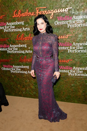 Dita Von Teese looked ultra classy at the Wallis Annenberg Center Inaugural Gala in a purple lace gown by Carolina Herrera featuring beaded shoulder accents.