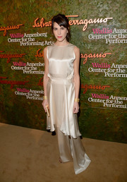 Caroline Sieber looked very dressy in a white Ferragamo evening dress with a tiered skirt during the Wallis Annenberg Center Inaugural Gala.