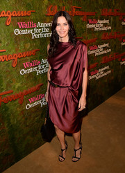 Courteney Cox Arquette looked effortlessly chic in an asymmetrical, draped burgundy cocktail dress by Thomas Wylde when she attended the Wallis Annenberg Center Inaugural Gala.