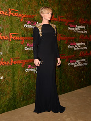 Charlize Theron looked regal at the Wallis Annenberg Center Inaugural Gala in a black Alexander McQueen evening dress with shoulder embellishments.