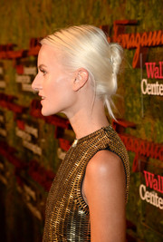Olympia Scarry fixed her platinum blond locks in an edgy-glam twisted bun for the Wallis Annenberg Center Inaugural Gala.