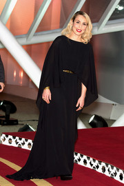 Noomi Rapace looked divine in a caped black gown by Elie Saab at the 'Waltz with Monica' photocall.