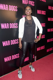 Leslie Jones teamed her leggings with a black mesh-neckline halter top.