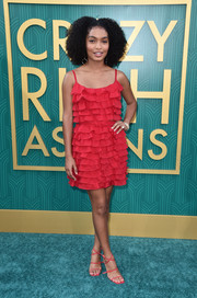 Yara Shahidi complemented her dress with red multi-strap heels by Off-White c/o Jimmy Choo.