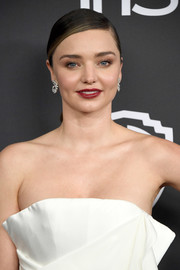 Miranda Kerr slicked her hair down into a neat side-parted ponytail for the Warner Bros. and InStyle Golden Globes post-party.