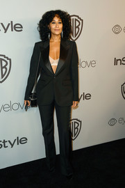 Tracee Ellis Ross flashed her white bra in a plunging black pantsuit by Marc Jacobs at the Warner Bros. and InStyle Golden Globes after-party.
